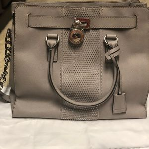 Michael Kors tote purse with lock.